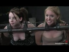 Three chained slutty chicks are lightly caned