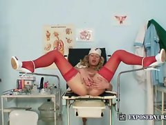 Sensual nurse in stockings masturbating her twat