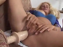 Stretching her mommy vagina with a lot of big toys