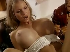 Light-haired nympho with enormous boobs riding prick