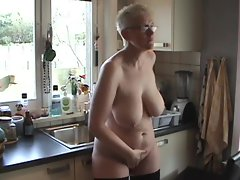 Big butt aged nude in her kitchen