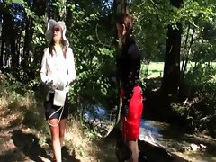 Lesbian clothed nymphos get moist in the river