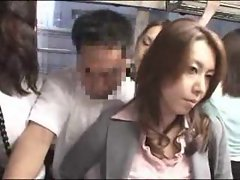 Asian slutty girl caresses his dick on a public bus