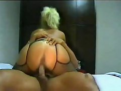 Blondie in mask bends over and makes love