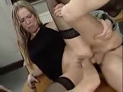 Cum lands in her mouth after they fist her pussy