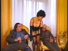 Girl in sensual gloves and her two men