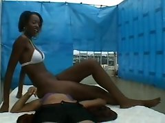 Ebony bikini lady facesitting on white young lady