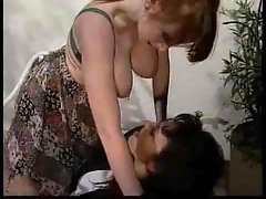 Attractive butch housewifes use a strapon for fun