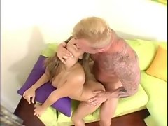 Attractive shaven young lady sits atop the stiff penis
