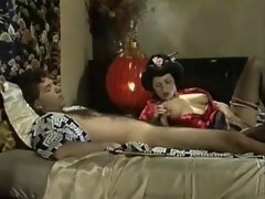 Geisha young lady in satin caresses a phallus