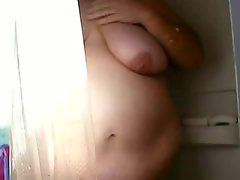 Obese amateur films her shower