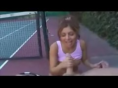 Tennis babe gives handjob on the court