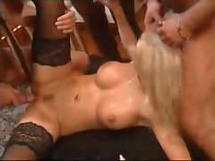 Tempting blonde in stockings gangbang with ebony fellows