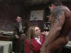 Gal in the office strokes on a phallus