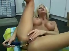 Bimbo tempting blonde gives her butt a nice toy banging
