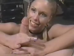 Braided hair young lady gives a xxl huge cock handjob