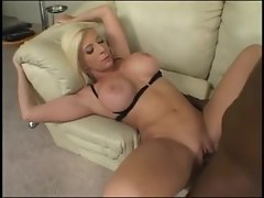 Blond with artificial hooters loves large dark shaft
