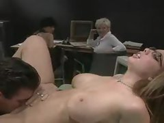 Sensual lass in the office caresses pecker in front of coworkers