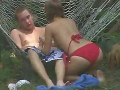 Voyeur video of couple banging in the backyard