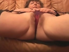 Shaggy Granny in stockings plays with panties then strips