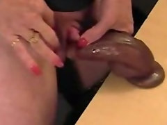 Attractive mature masturbates big clit with black toy