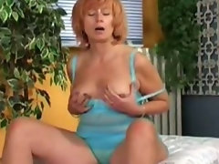 Redhead mature's doing herself