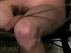 Tied up hunk has a rope tied narrow around his dick