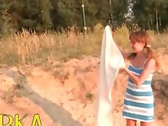 Slutty russian tart demonstrates pinky on the attractive sand