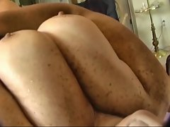 Jerking a wad on to wifes huge boobs.