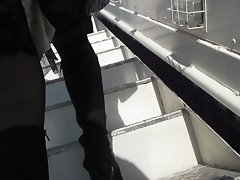 Lady in ebony stockings on a plane stair
