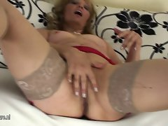Older attractive mature vixen playing with herself