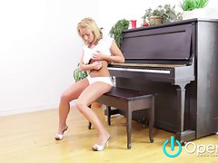 Blond with Mega big melons Masturbates on Piano