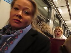 chick flashing fishnet stockings in a train