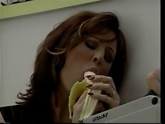 Lewd dark haired entices chap with banana then licks his penis