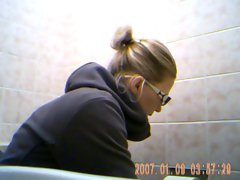 Awesome 19 years old young lady spied on toilet 3