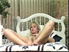 Blond tart massaging her pussy with her fingers