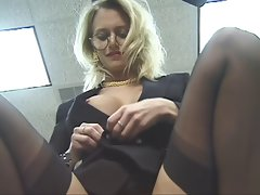 Office gal strips and spreads her thighs