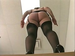 Frisky office vixen in stockings gets banged by long toy