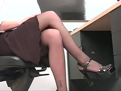 Professional 18 years old light-haired spreads her pinky muff at desk