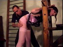 Dark-haired wench gets her butt spanked by a paddle