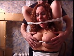 Big melons redhead has her hooters teased by her master