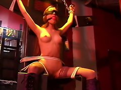 Tart with a gorgeous rack, bound, with her legs spread for her master