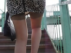 Lass in tan stockings going upstair