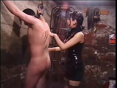 Sensual asian dominatrix whips sex slave in bondage basement