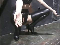 Attractive cutie in mask and rubber gets tortured