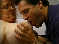 Experienced whore gets her obese knockers stroked by stud
