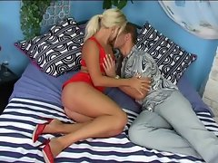 Tempting blonde tart in red lingerie caresses on a long shaft
