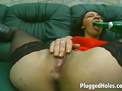 Sensual girlie sticks a bottle in her snatch