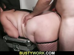 Fatty dark haired in fishnets receives it from behind