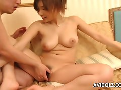 Big titted redhead fills her pinkish twat with a gigantic toy